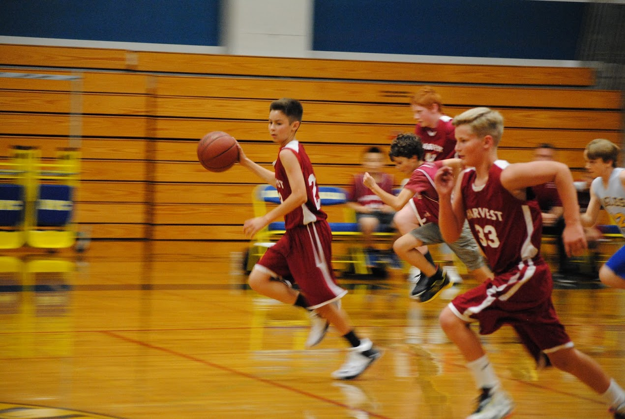 player dribbling down basketball court