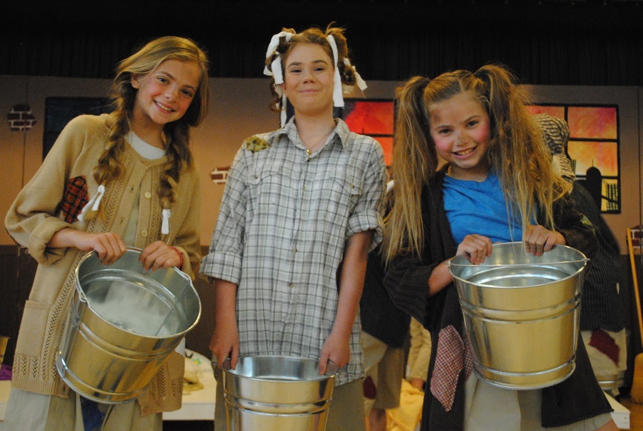three cast members from Annie