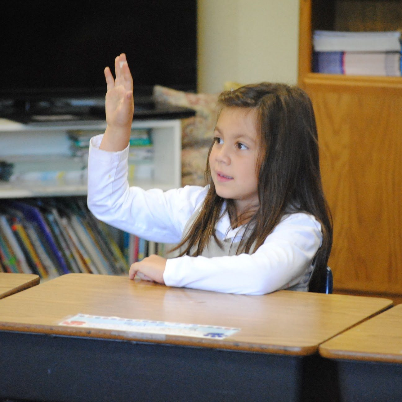 young female student raising hand