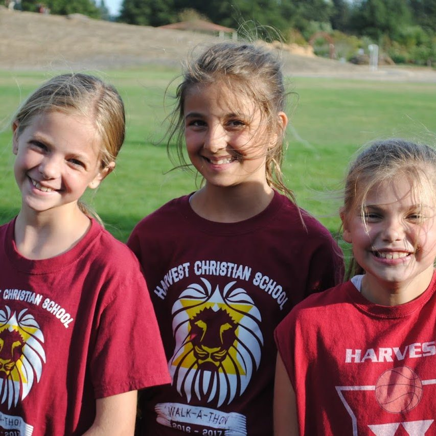 three female hcs cross country runners